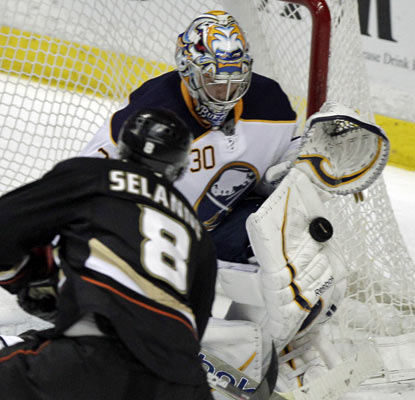 Ryan Miller stonewalls the Ducks with a season-high 43 saves for his fourth shutout of the season.  (AP)