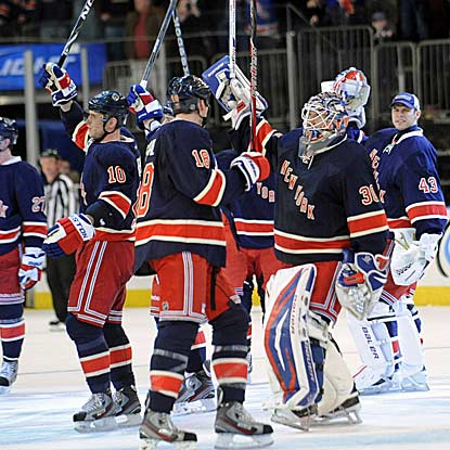 The Rangers salute the home crowd after their latest triumph, a close victory over the Bruins.  (AP)
