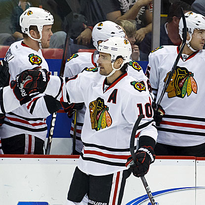 Patrick Sharp scores one goal and assists on the other in the Blackhawks' win against the Red Wings. (US Presswire)