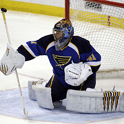 Jaroslav Halak wins his sixth straight start to lift the Blues over the Blackhawks and move atop the NHL.  (AP)