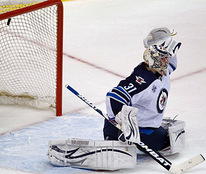 Jets goalie Ondrej Pavelec is beaten high by Samuel Pahlsson (not pictured) for the winning goal. (AP)