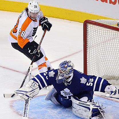Claude Giroux puts one past Maple Leafs goalie Jonas Gustavsson in the shootout to lift the Flyers to victory.  (US Presswire)