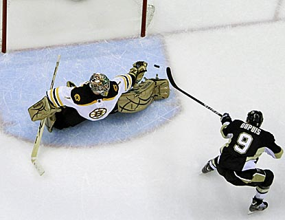 Pascal Dupuis (9) flips a backhander past the glove of Boston goalie Marty Turco during the third period.  (AP)
