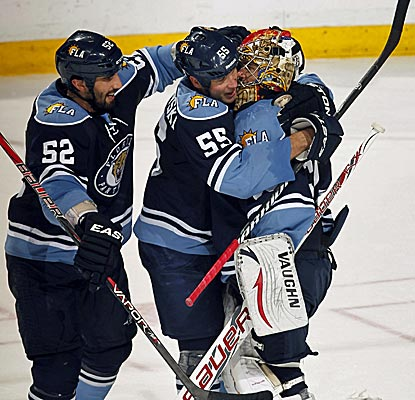 Panthers' goalie Jose Theodore is congratulated by teammates after recording his third shutout of the season.  (Getty Images)