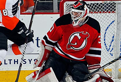 To keep the Devils streaking toward the playoffs, goalie Martin Brodeur earns his 650th victory.  (Getty Images)