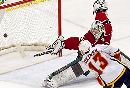 Olli Jokinen scores a goal as the Flames move into an eighth-place tie with the Avalanche.  (AP)