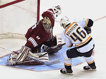 Nashville's Andrei Kostitsyn scores the lone goal of the shootout against Phoenix goaltender Mike Smith.  (AP)
