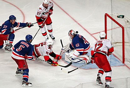 Backup Martin Biron steps in for Henrik Lundqvist, who is out with the flu, and helps the Rangers with 27 saves. (US Presswire)
