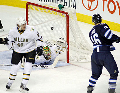 Andrew Ladd tallies two goals as Winnipeg deals Dallas its first regulation loss since Feb. 19. (US Presswire)