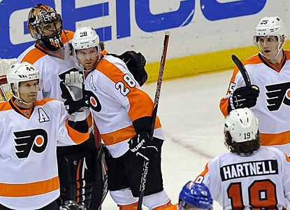 Flyers teammates appreciate Ilya Bryzgalov's outstanding effort. Bryzgalov came within 6:30 of a fourth shutout in a row. (AP)