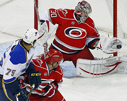 Cam Ward stops 40 shots against the NHL-leading Blues, earns his 20th career shutout and 200th career victory. (AP)