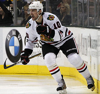 Patrick Sharp scores goals at almost identical times early in the first and third periods. (AP)