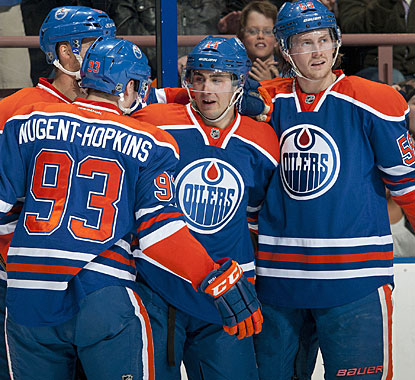 Ryan Nugent-Hopkins, who scores 2 goals, and Jordan Eberle (center), who has 2 assists, celebrate a first-period goal. (Getty Images)