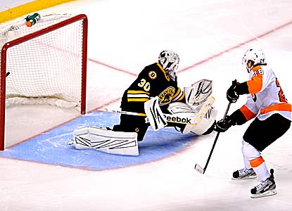 Tim Thomas says it was a 'hard, 65-minute effort today' after making the winning save in the shootout. (Getty Images)