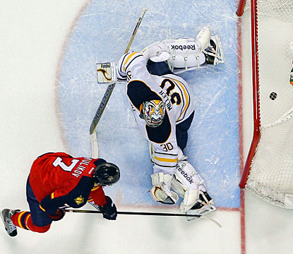 Dmitry Kulikov, back after missing 23 games, lifts the puck over goalie Ryan Miller's blocker for the decisive goal. (Getty Images)