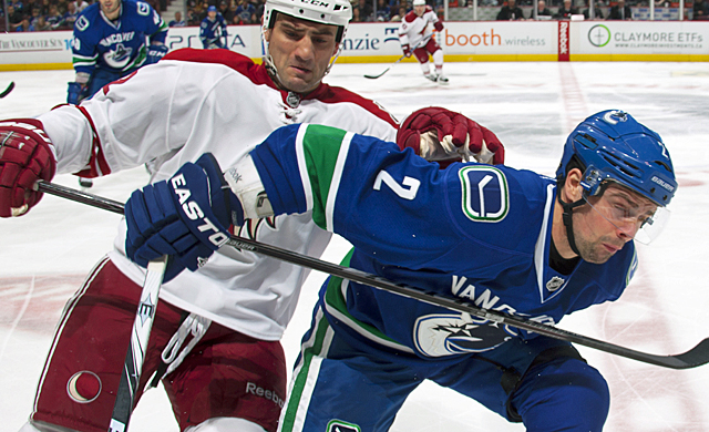 Dan Hamhuis and the rest of the Canucks' defense is failing to help the offense move the puck. (Getty Images)