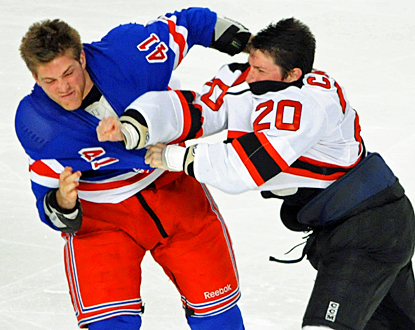 The Rangers and Devils set the tone early for this game, starting three fights three seconds into the first period. (AP)