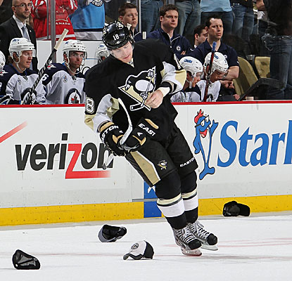 Pittsburgh fans appreciate James Neal's second career hat trick by throwing hats on the ice. (Getty Images)
