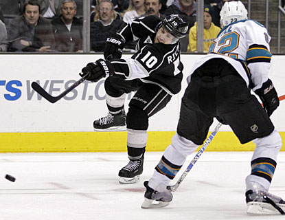 Mike Richards matches his teammate Anze Kopitar with one goal and two assists each against San Jose. (AP)