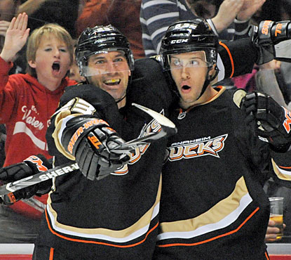 Francois Beauchemin celebrates Nick Bonino's (right) goal as the Ducks beat the Blues for the fifth straight time at home. (US Presswire)