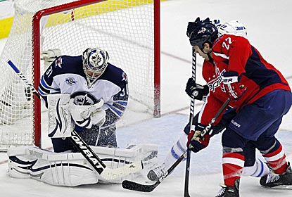 Jets goalie Ondrej Pavelec makes a save as Winnipeg comes back from three down to win.  (US Presswire)