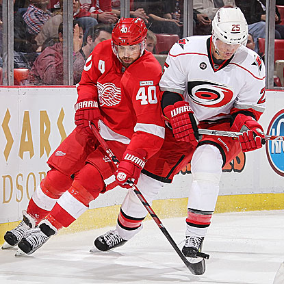Henrik Zetterberg scores two goals in the second period to close the Red Wings' deficit to one. (Getty Images)