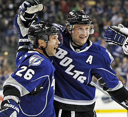 Steven Stamkos (right) celebrates one of his goals, tying the team record of 52. Martin St. Louis assists on Stamkos' goals. (AP)