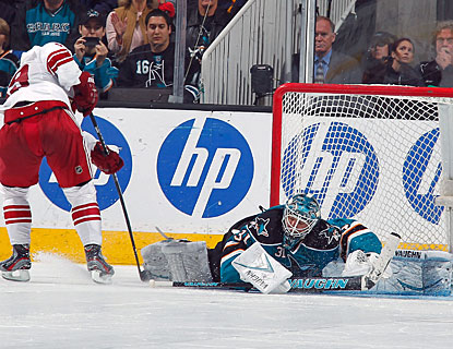 Antti Niemi stops both Coyotes shooters in the shootout after also making 24 saves through overtime. (Getty Images)