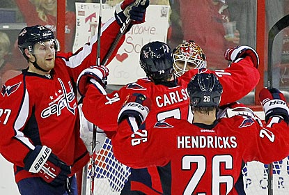 Capitals goalie Braden Holtby is congratulated after holding off a late power play to preserve a shutout.  (US Presswire)