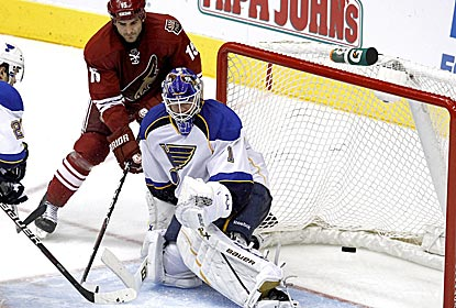 Brian Elliott makes one of his 20 saves as St. Louis ties a record with its 14th shutout of the year.  (AP)