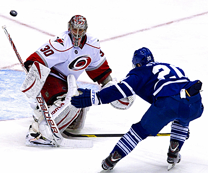 Carolina's Cam Ward stops all 32 Maple Leafs' shots to record his fifth shutout of the season. (AP)