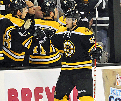 Benoit Pouliot celebrates with teammates after scoring the tiebreaking goal in the third period. (US Presswire)