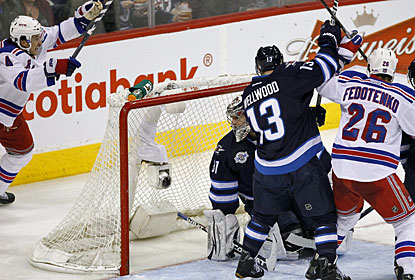 Michael Del Zotto (left) scores a short-handed goal to start New York's comeback with four unanswered goals. (AP)