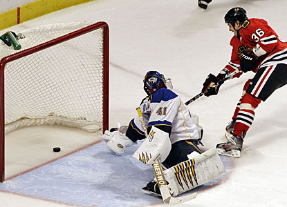 Dave Bolland beats Jaroslav Halak with the only goal in the shootout to give Chicago the win. (AP)