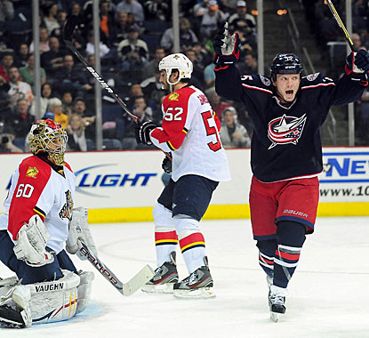 Derek Dorsett celebrates defenseman Nikita Nikitin's (not pictured) power-play goal in the second period. (US Presswire)