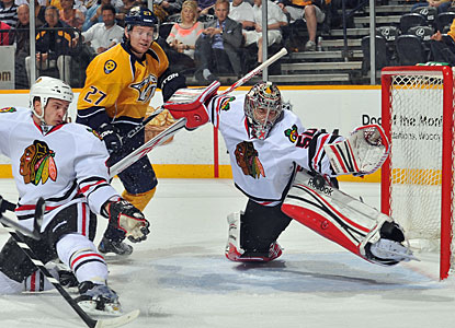 Corey Crawford makes one of his 29 saves to help Chicago beat Nashville for the first time this season. (Getty Images)