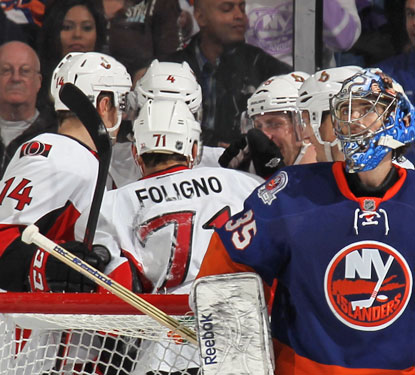 Ottawa's Nick Foligno celebrates with teammates after scoring on Isles goalie Al Montoya in the second period.  (Getty Images)