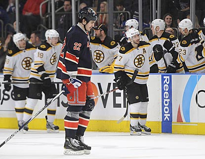 While the Bruins celebrate their division title, Brian Boyle and the Rangers lament a missed chance at clinching the East.  (AP)