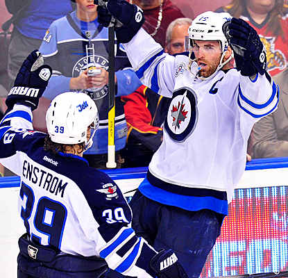 Andrew Ladd celebrates after scoring the game-winning goal to complete the Jets' comeback against the Panthers. (US Presswire)