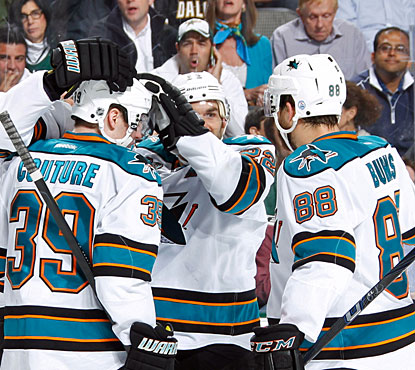 Sharks players celebrate Logan Couture's power-play goal which breaks a 2-2 deadlock late in the second period. (Getty Images)