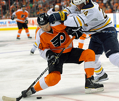 The Sabres push Matt Read around, but the Flyers' forward scores the game-winning goal for the Flyers. (US Presswire)
