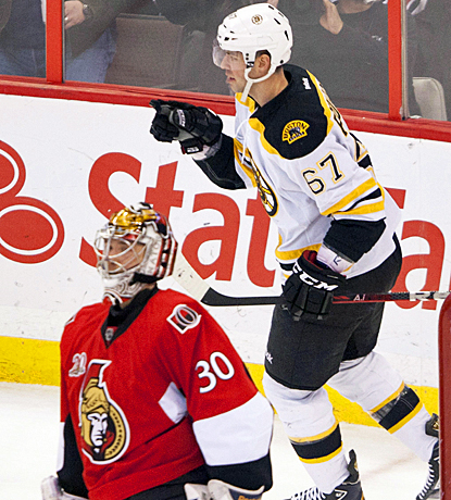 Benoit Pouliot opens the scoring for the Bruins with his goal in the first period against Ottawa's Ben Bishop. (AP)