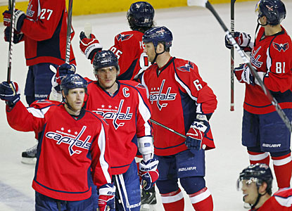 Capitals players salute the crowd after securing their playoff berth with one game to spare. (US Presswire)