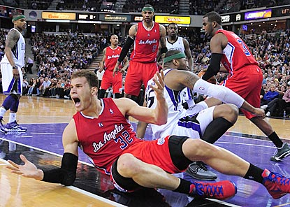 Blake Griffin reacts after getting tangled up with DeMarcus Cousins (right) in the fourth quarter of their testy matchup.  (US Presswire)