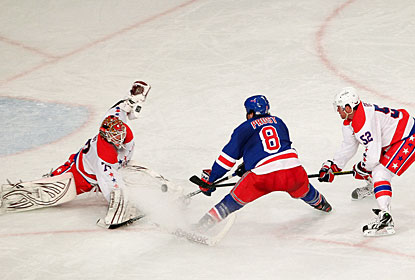 Rookie goalie Braden Holtby stops the Rangers' Brandon Prust on a breakaway scoring opportunity. (US Presswire)