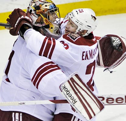 Goalie Mike Smith and Oliver Ekman-Larsson celebrate a historic division title for the Coyotes.  (AP)
