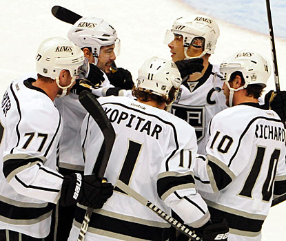 Kings players celebrate their big win after Dustin Penner scores with just over three minutes to play. (US Presswire)