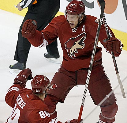The Coyotes' Martin Hanzal celebrates his game-winning goal as Phoenix retains home ice with an overtime win.  (AP)
