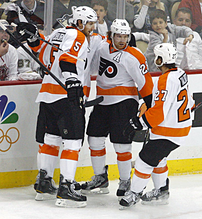 Claude Giroux (center) celebrates one of his three goals in the Flyers' win over the Penguins. (US Presswire)