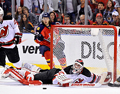 Martin Brodeur makes one of his 24 saves during his 100th postseason win. (US Presswire)